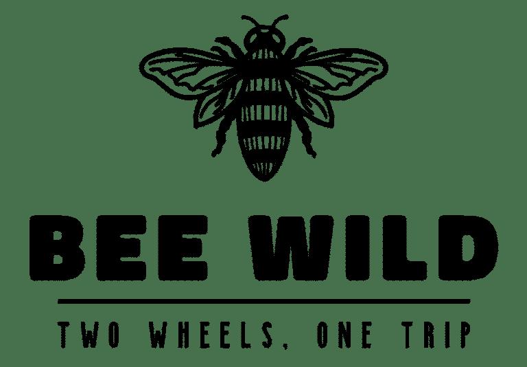 Logo beewild en noir avec le slogan two wheels, one trip